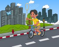 Little boy playing bicycle on the street cartoon Stock Photo
