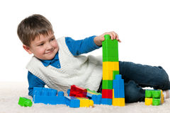 Little boy is playing with blocks royalty free stock photography