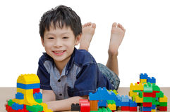 Little boy playing blocks Stock Photo