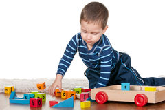 Little boy playing blocks on the carpet Royalty Free Stock Photos