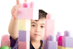 Little boy playing blocks at home stock image