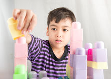 Little boy playing blocks at home Stock Photo