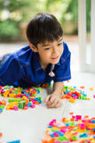 Little boy playing blocks toy indoor activities Royalty Free Stock Images