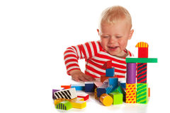 Little boy is playing with blocs Stock Photo