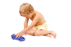 Little boy playing with blue toy car Stock Image