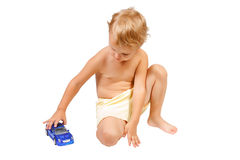 Little boy playing with blue toy car Royalty Free Stock Photo