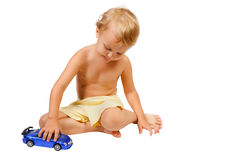 Little boy playing with blue toy car Royalty Free Stock Image