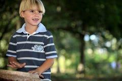 Little boy playing bongo s Stock Photography