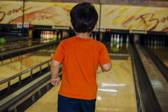 Little boy playing bowl royalty free stock images