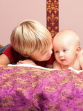 Little boy playing with a brother Royalty Free Stock Image