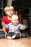 Little boy playing with a brother Stock Images