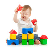 Little boy playing with building blocks. Little boy playing with colored building blocks Royalty Free Stock Image