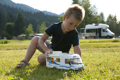 Little boy playing at camping site. Backlight royalty free stock photos