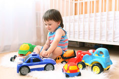 Little boy playing cars Stock Photography