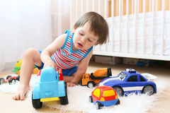 Little boy playing cars at home Stock Photography