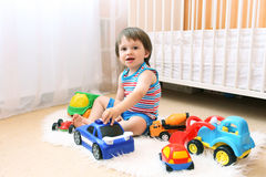 Little boy playing cars at home Royalty Free Stock Photos