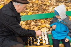 Little boy playing chess with his Grandpa Royalty Free Stock Image