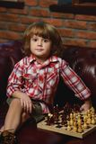 Little boy playing chess. At home. Games and activities for children. Family concept royalty free stock photography