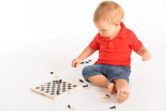 Little boy playing chess Stock Photography