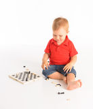 Little boy playing chess Stock Photos