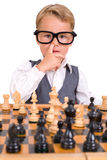 Little boy playing chess Stock Photo