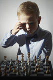 Little boy playing chess.Smart Little genius Child. Intelligent game.Chessboard Stock Images