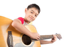 Little boy playing classic guitar course on white background Stock Images