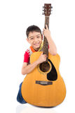 Little boy playing classic guitar course on white background Stock Photography