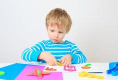 Little boy playing with clay dough Royalty Free Stock Photography