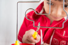 Little boy playing coil spark with concentrate Royalty Free Stock Photo