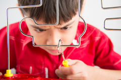 Little boy playing coil spark with concentrate Stock Image