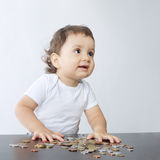 Little boy playing with coins Royalty Free Stock Photo