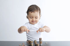Little boy playing with coins Royalty Free Stock Images