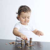 Little boy playing with coins Royalty Free Stock Photos