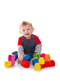 Little boy playing with colored soft cube Royalty Free Stock Photography