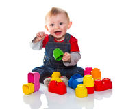 Little boy playing with colored soft cube Stock Photography
