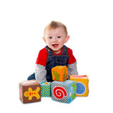 Little boy playing with colored soft cube Stock Images