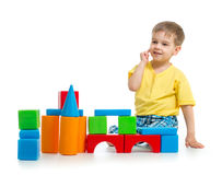 Little boy is playing with colorful building block. S on white royalty free stock photo