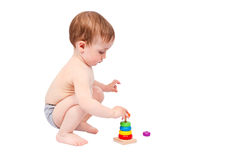 Little boy playing with colorful pyramid Stock Image