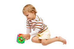 Little boy playing with colorful toy Stock Image