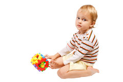 Little boy playing with colorful toy Royalty Free Stock Photography
