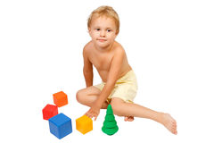 Little boy playing with colorful toys Stock Photos