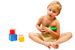 Little boy playing with colorful toys Royalty Free Stock Photo