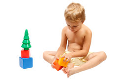 Little boy playing with colorful toys Royalty Free Stock Images