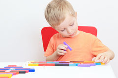 Little boy playing with colourful toys Royalty Free Stock Photos