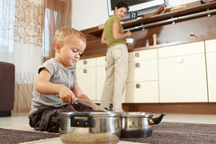 Little boy playing with cooking pots Royalty Free Stock Photo