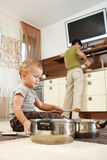 Little boy playing with cooking pots Royalty Free Stock Photography