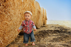 Little boy playing in a cowboy hat Stock Images