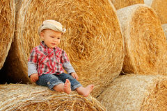 Little boy playing in a cowboy hat Stock Image