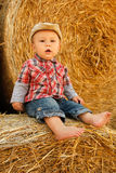 Little boy playing in a cowboy hat Royalty Free Stock Photo